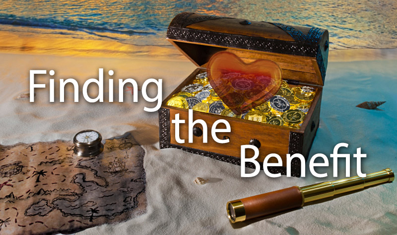 Picture of a beach shore with an open treasure chest filled with sparkly coins with a heart superimposed overtop. The words Finding the Benefit are written in bold on the image